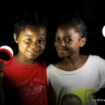 Two Haitian girls with Nokero bulbs received through our partnership with EarthSpark International