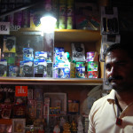 A man uses solar light in his shop in India