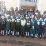 Students in Kampala, with Hon Twaha Kawaase (Minister of Education for Buganda Kingdom)