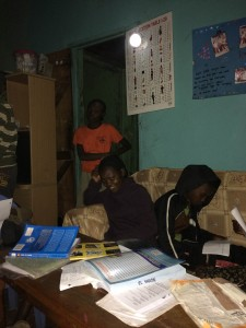 El Shaddai orphans study under solar lighting